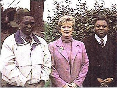 (L-R)  Jim Lyons Sr., Linda Lee Cadwell, Joe LeGrand at Bruce and Brandon Lee's grave site.