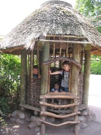 Kids enjoying an African  hut at the Seattle Zoo