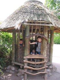 Kids enjoying an African  hut at the Seattle Zoo